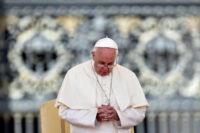 Pope Francis prays in St. Peter's Square. (CNS photo/Ettore Ferrari, EPA)