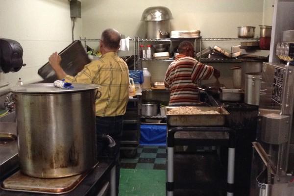 Volunteers prepare dinner for Grace Cafe. Photo by Barbara Wheeler-Bride
