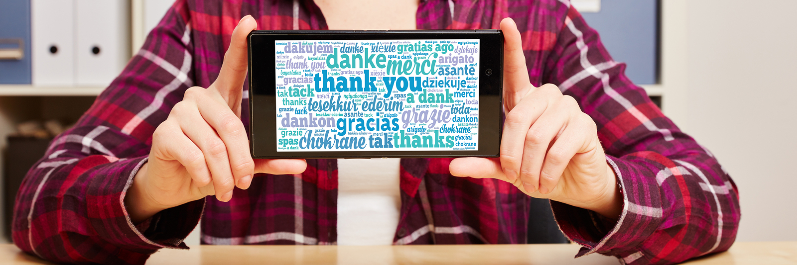 Thank you in different languages on a smartphone's touchscreen