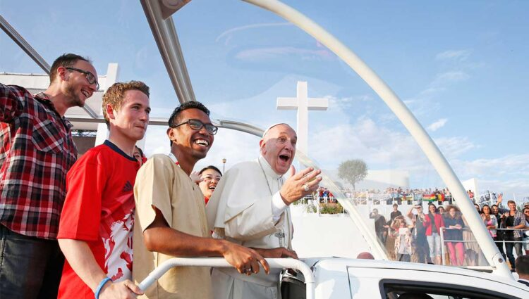 Pope Francis rides with pilgrims in the popemobile at World Youth Day. (CNS photo/Paul Haring)