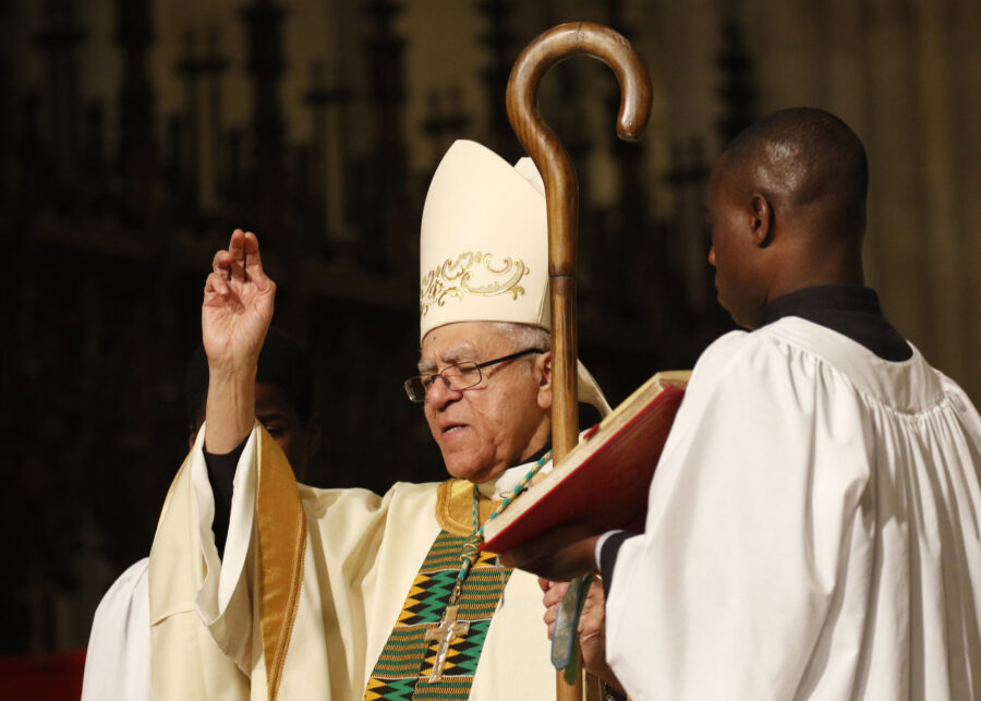 Retired Auxiliary Bishop Guy Sansaricq of Brooklyn, N.Y., imparts the final blessing at an annual Mass celebrated for Black History Month at St. Patrick's Cathedral in New York City.