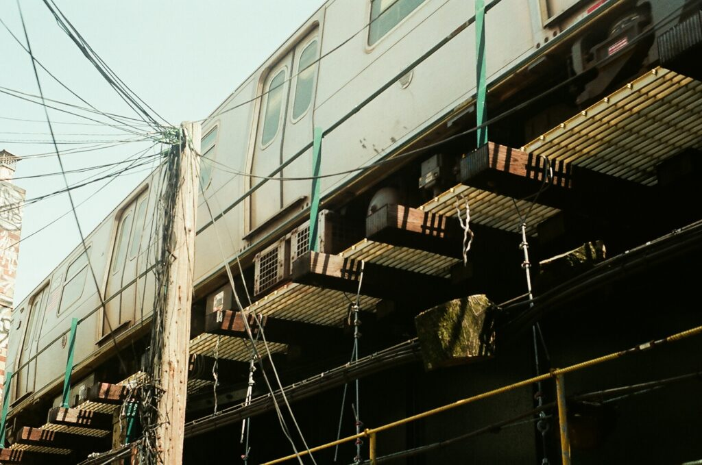 Power lines next to an above-ground subway car in New York City