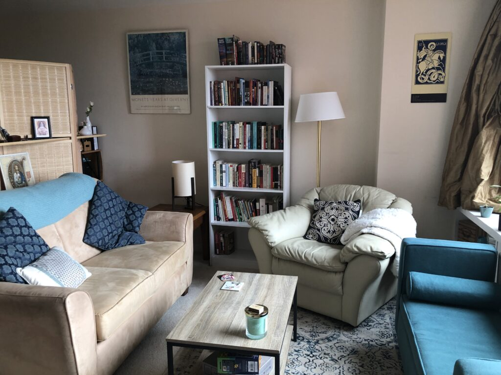 A well-arranged living room with tan and blue sofas