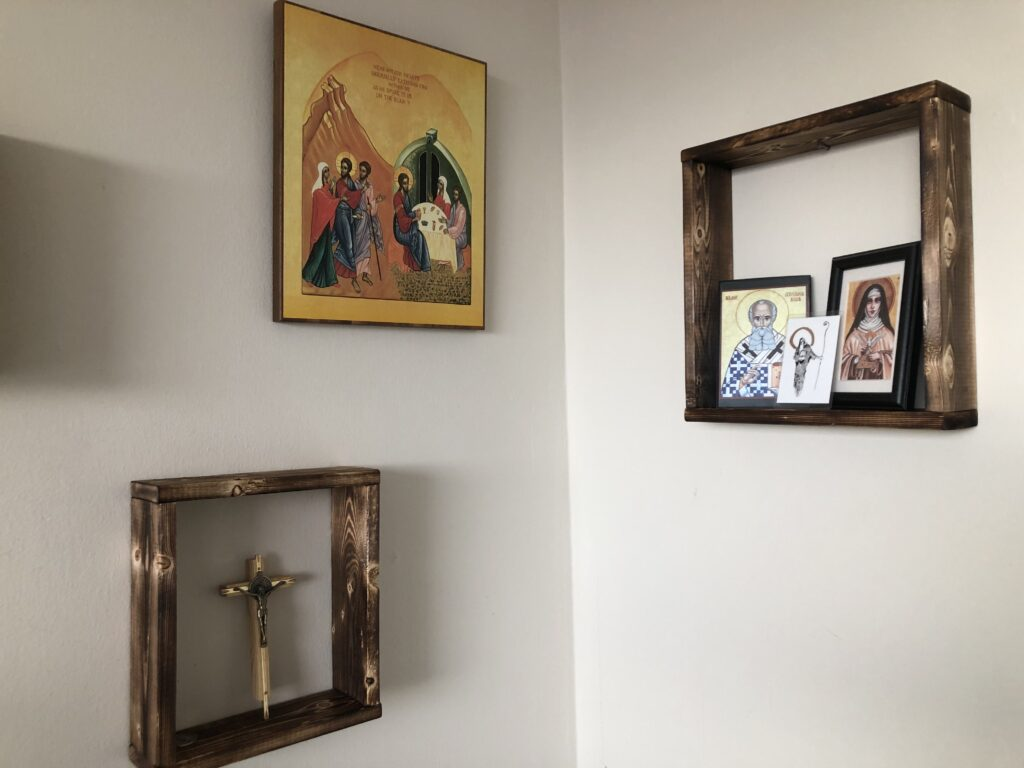 Religious art adorning a corner space in a home