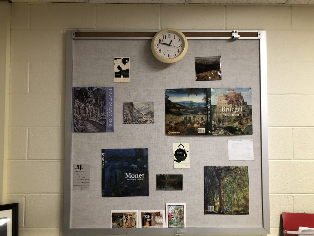 A bulletin board with inspirational quotes and artwork