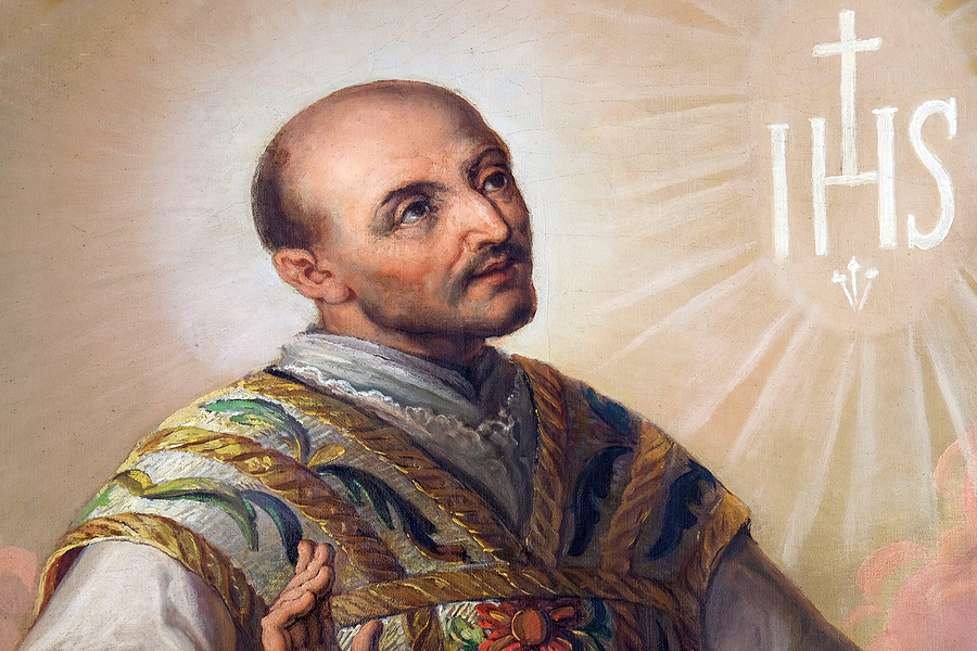 image of St. Ignatius from altarpiece in Zagreb, Croatia. IHS is to the right of his face.